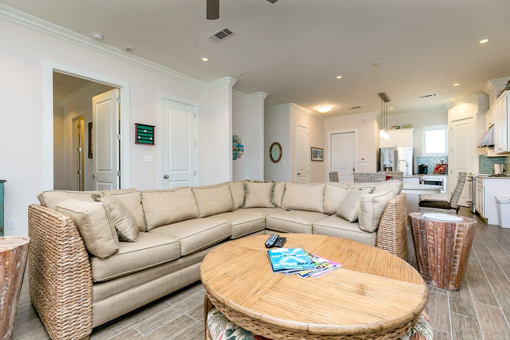 Relax in the comfy, beach-inspired sectional in the living area.