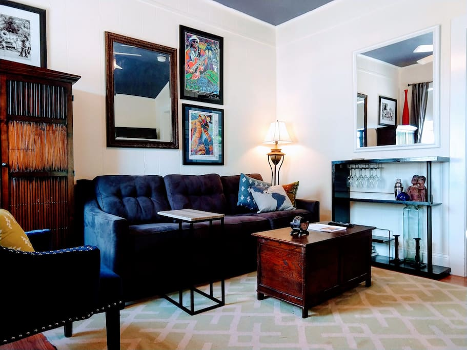 Queen sized pullout sofa and mini bar in living area