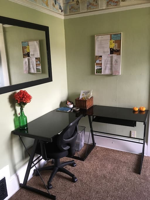Great work station with large desk and supportive desk chair!