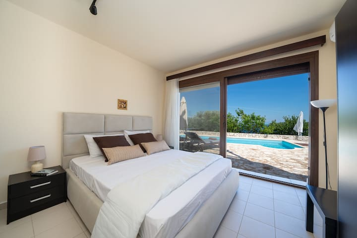 lower pool level bedroom with double bed