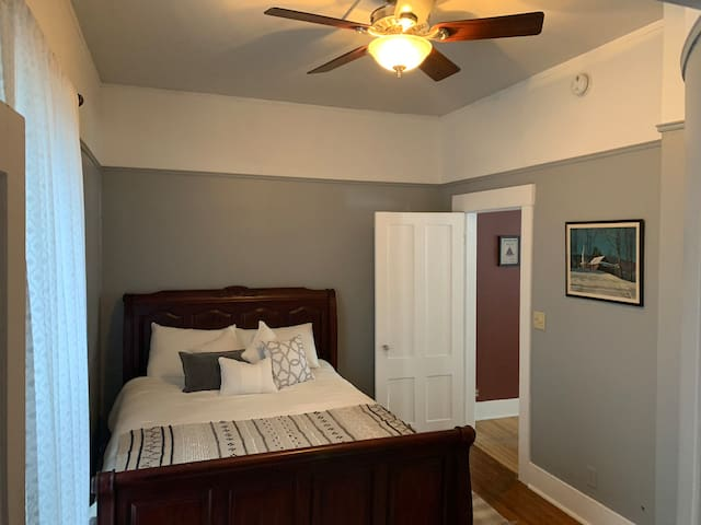 Bedroom #1 - Queen with closet/built in drawers, and ceiling fan.