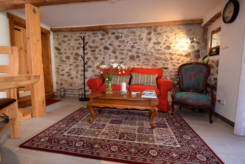 Living area with original stone wall.