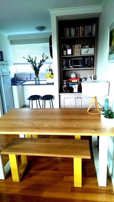Start your day basked in sunlight while eating/reading at this dining room table.