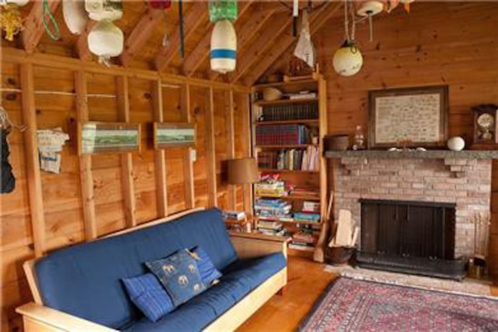 Family room with working fireplace-a place where kids can play.
