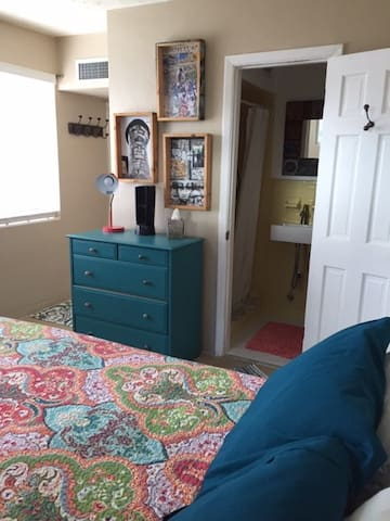 Dresser with towels, blankets, and shampoos etc.