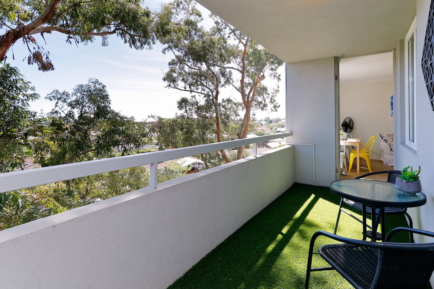 Over-sized balcony to enjoy a leafy outlook during the day or sunsets at night.