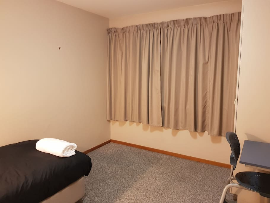 Room with a single bed and desk