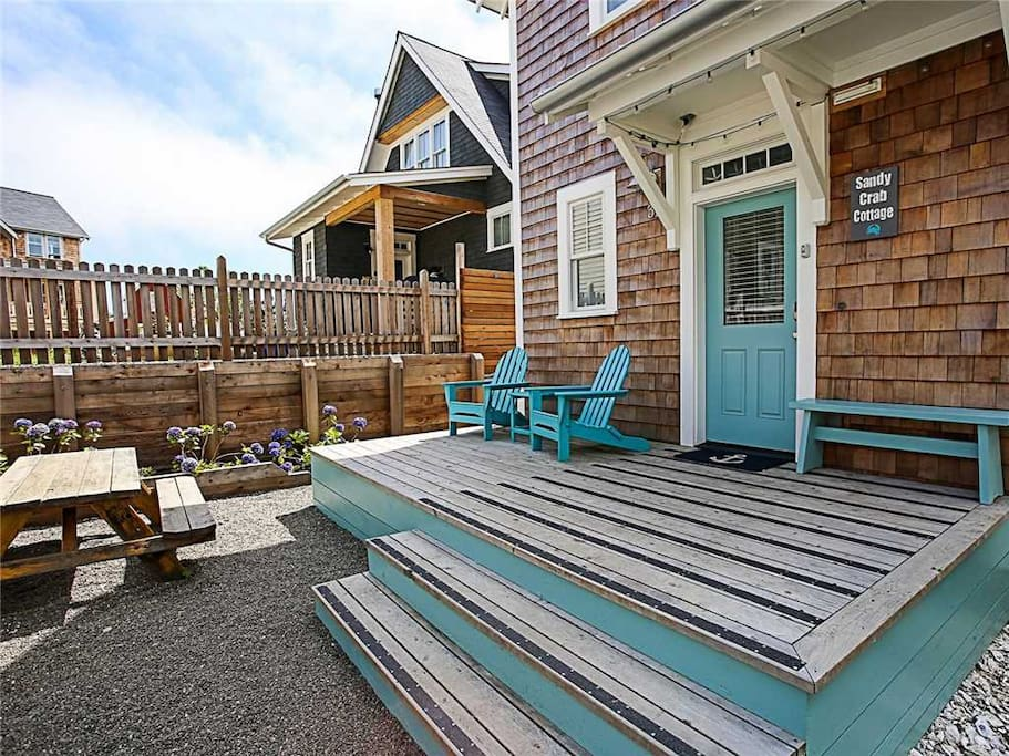 Front entry with adirondack chairs and picnic table