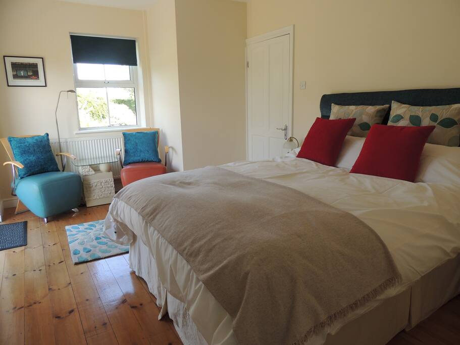 The Meadow Bedroom. Kingsize bed. A gorgeous sunny room. French doors open onto a private patio area.