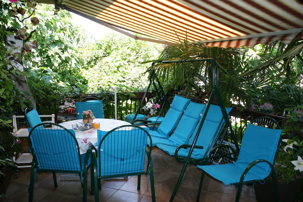 Terrace has garden furniture, swing chair, fireplace (charcoal) and gas grill