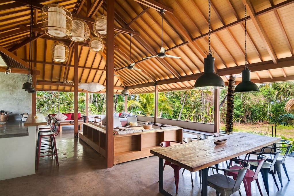 Large open living, dining room with jungle and ricefield views. Enough space for yoga, kids to run around. Or relax at home the whole day.