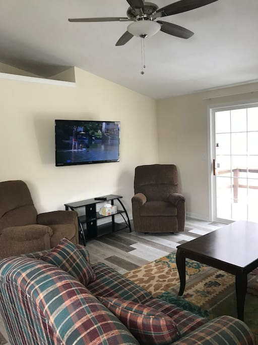 Living room with ceiling fan and smart television