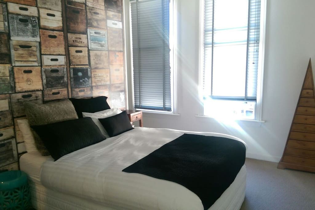 Master Bedroom with double glazed windows, queen size bed, walk through robe and ensuite