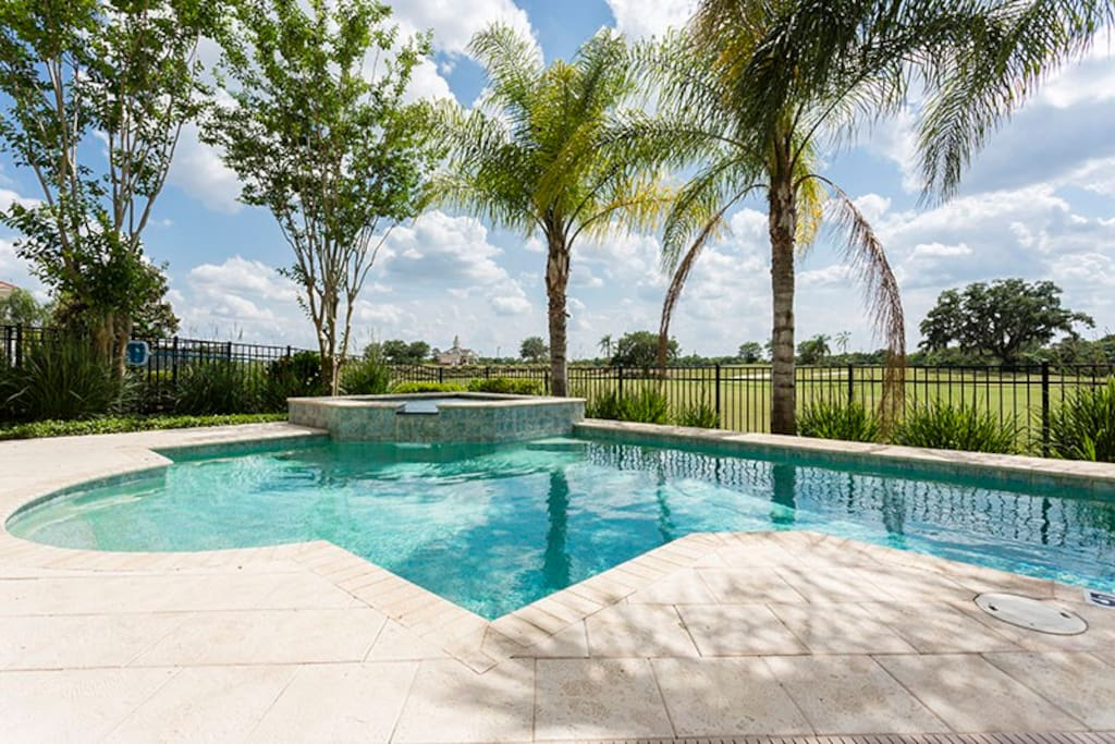 Take a dip in your private pool and spa overlooking the golf course