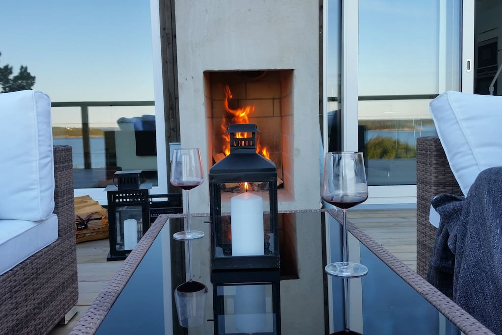 Relax in front of outdoor fireplace