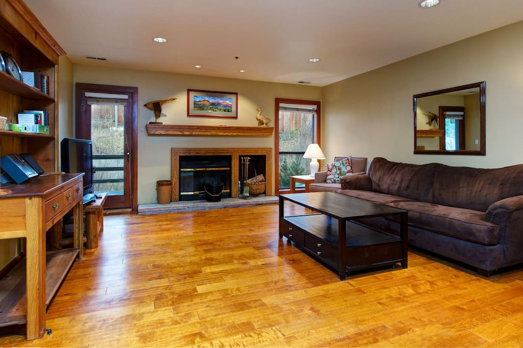 Warm hardwoods and a comfy sofa in the living area.