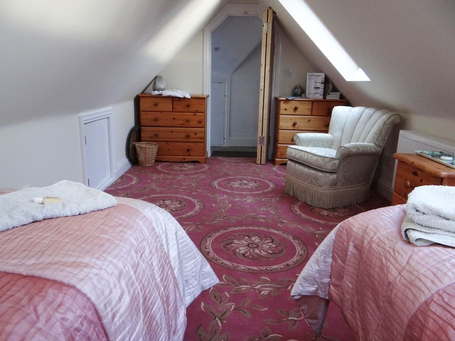 Loft suite is brand new and modern. The bedroom is bright and airy it is a large comfortable  room with sloping ceilings from a central height of 7ft.