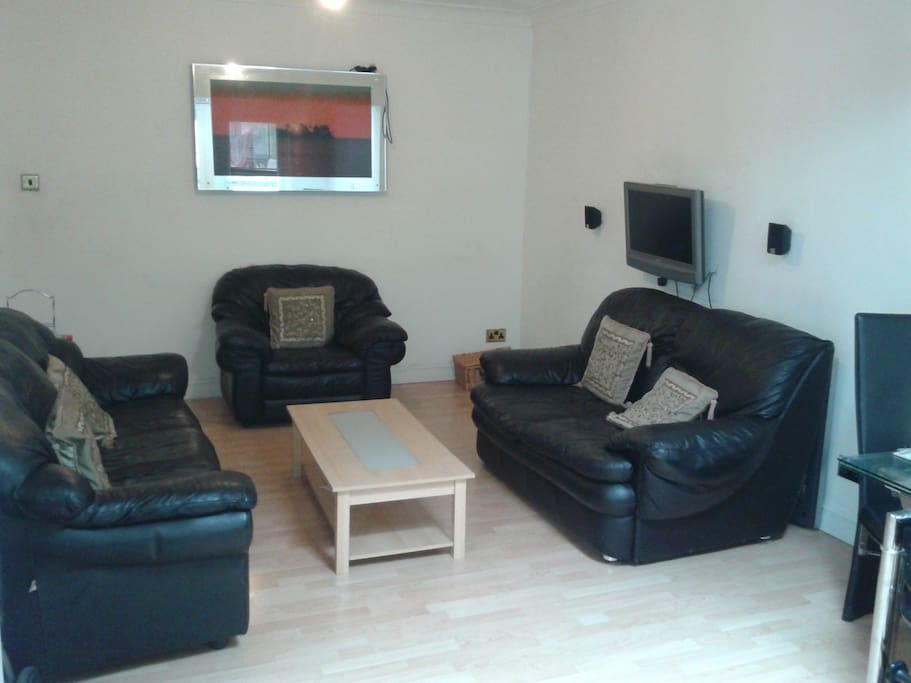 Spacious Lounge Area with TV