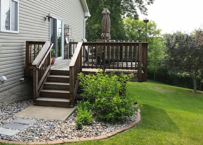 deck with gas grill and patio furniture