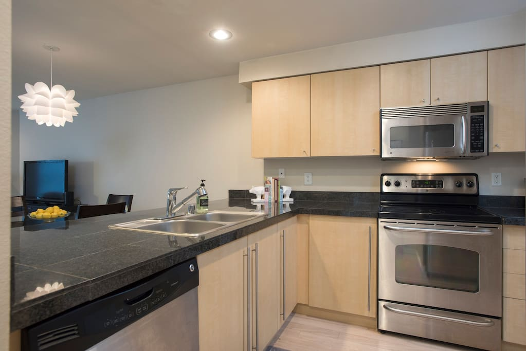 Fully stocked kitchen with stainless steal appliances.
