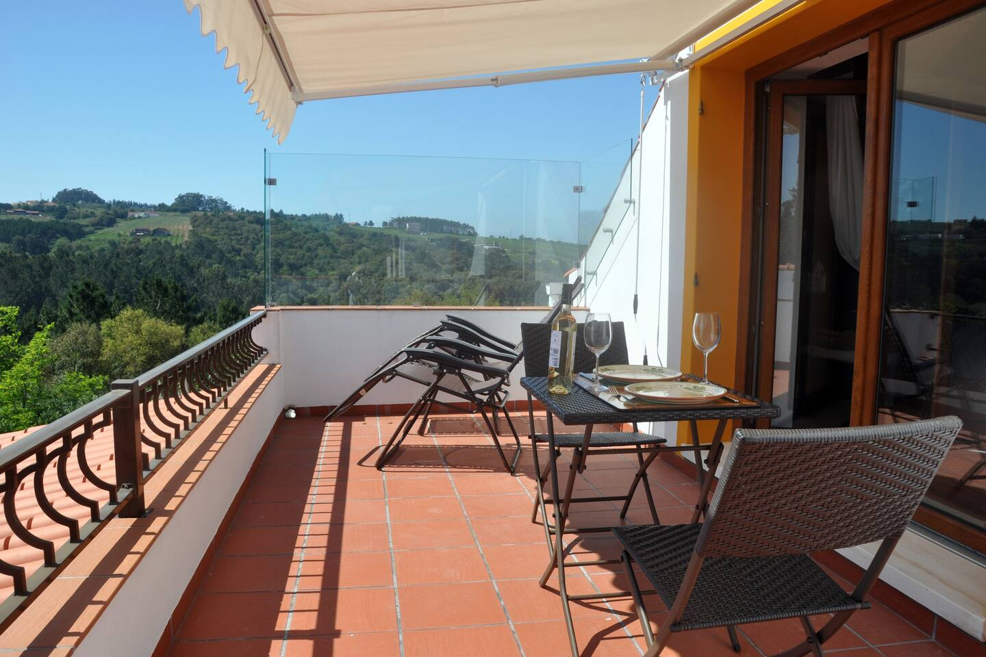 A glass windbreak AND a sun awning maximises terrace time