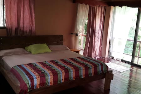 Master bedroom with balcony - Surfside, Playa Potrero