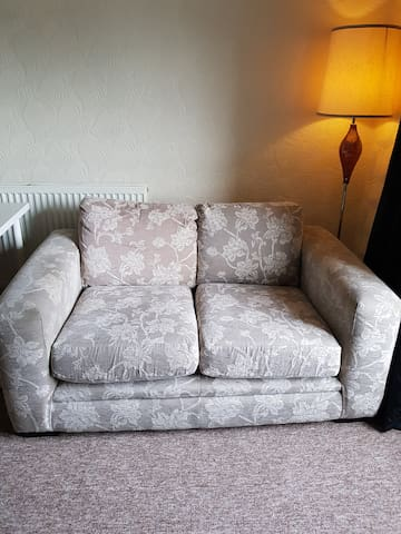 This is a large room, we have put a 2 seater sofa and a TV for extra comfort.