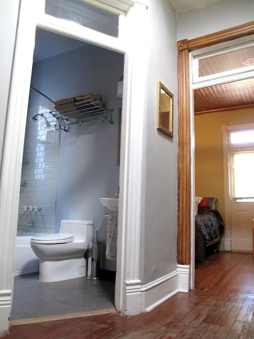 On the left is your bathroom [shared between two guest rooms—you also have access to a half bath on the first floor if this one is occupied]. Your room is on the right