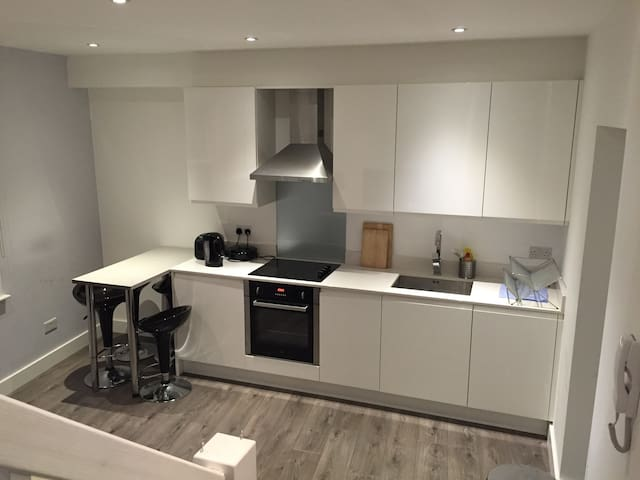 The Open Plan Kitchen With Bar Table.