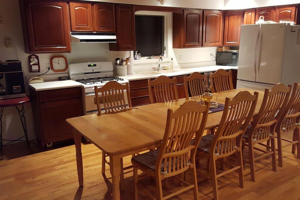 The well-equipped main kitchen with double oven, commercial BUNN coffee maker and french-door refrigerator.