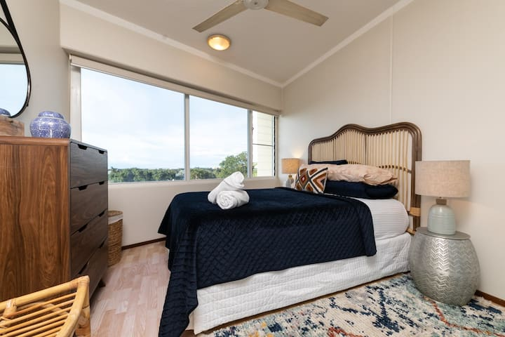 Master bedroom with large windows to capture the stunning views.