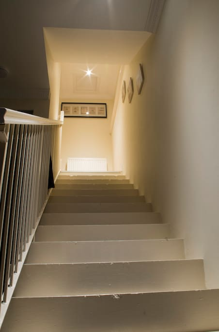 Stairs from the lounge to the bedroom