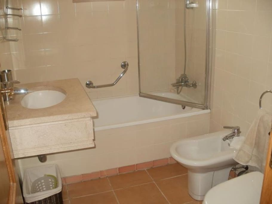 Bathroom plus another toilet and washbasin