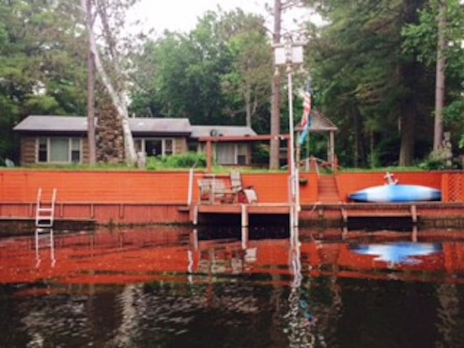 Ample indoor space, large lot, dock space, swim area with beach sand, and kayaks make this lake oasis the ideal location to create lasting summer memories.