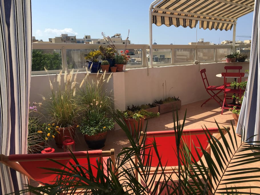 The spacious terrace has sun chairs,  bistro table and awning to allow you to enjoy sunbathing and al fresco dining even in the hottest days