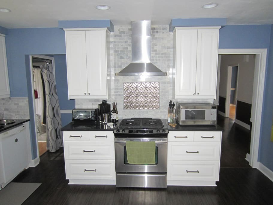 Full Kitchen with Coffee Maker, Oven, Range, Microwave and Toaster Oven.
