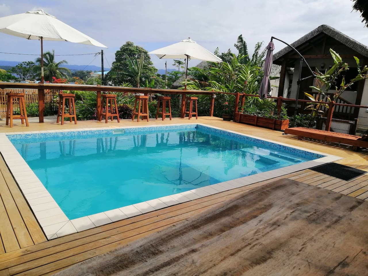 The completed outdoor pool/ lounge area with the Kiwi Nest in the background