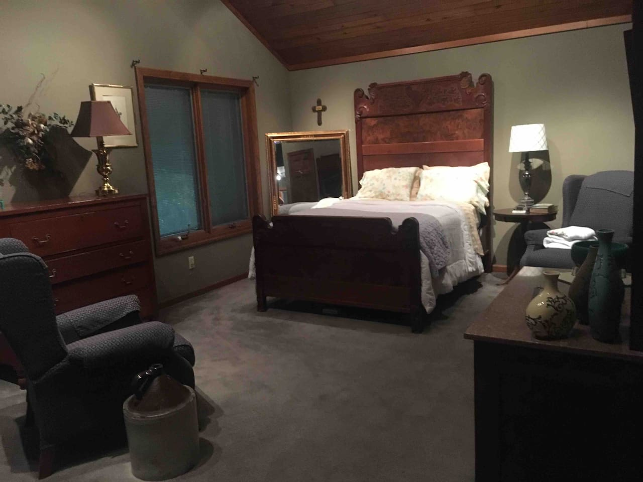 Large room with a regular size bed.