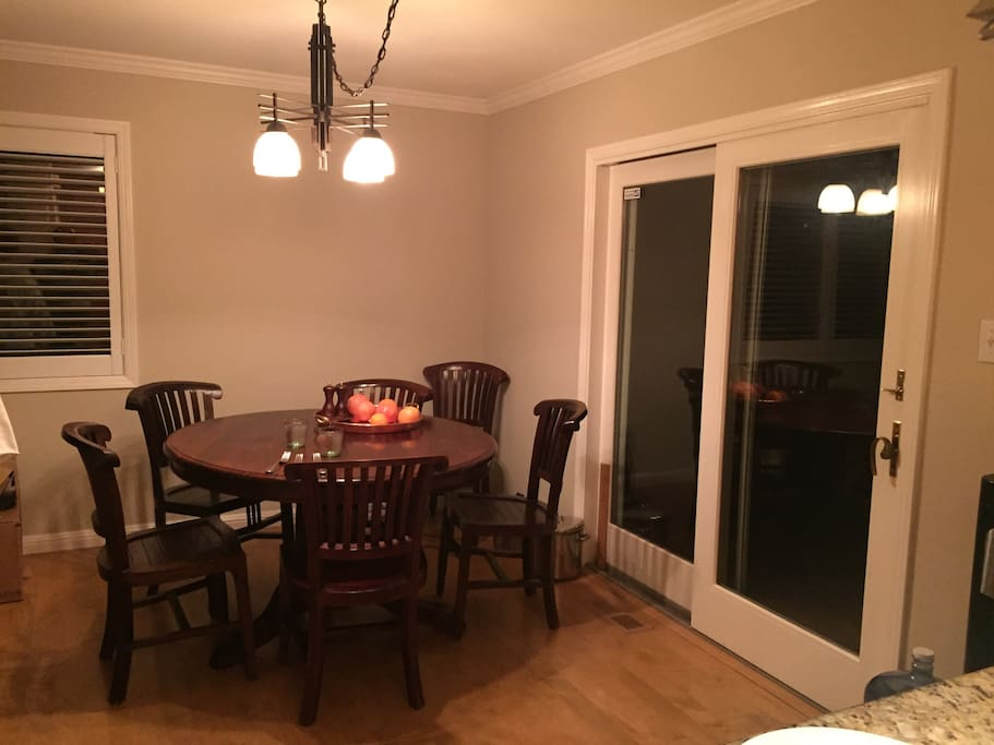 Dining room - recycled teak wood table seats many