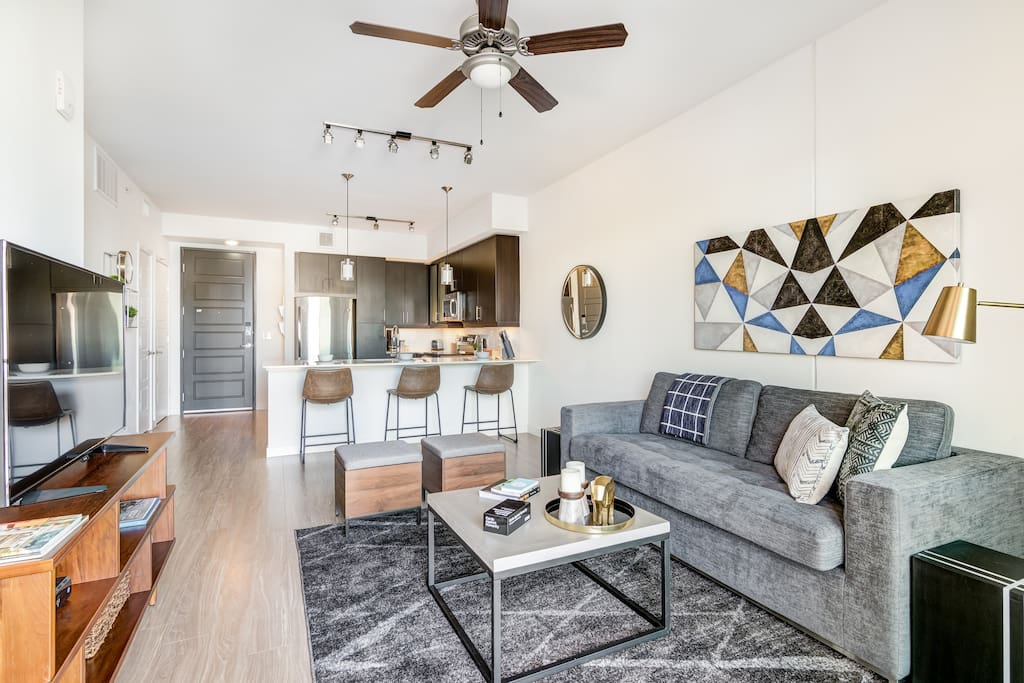 Relaxing living area, with fun amenities like games, TV, bar seating!