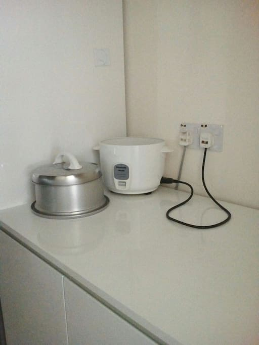 Rice cooker to cook rice.