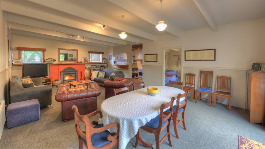 The spacious lounge dining room with wood and electric heating for all year round comfort.