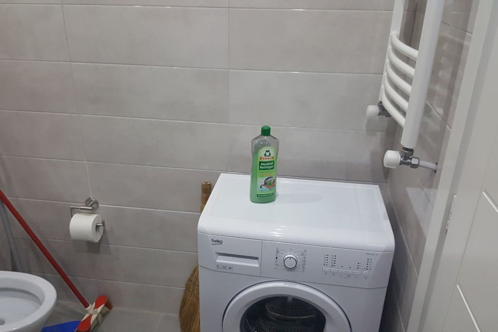 There is a washing machine in toilet for use
