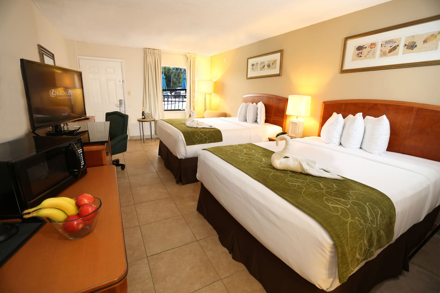 This room features a microwave, mini fridge, and flat-screen TV with premium movie channels. A desk is also included