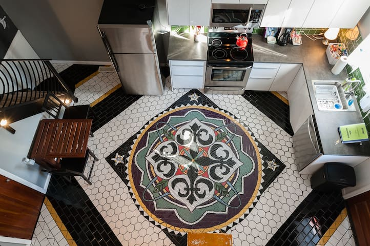 View of the kitchen mosaic floor from the loft window.