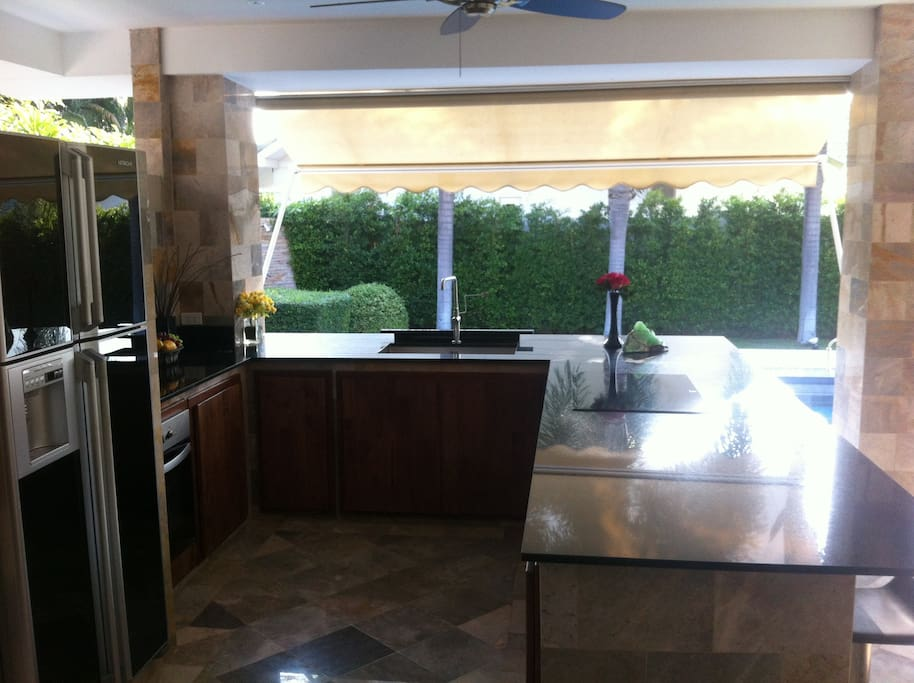 Full outdoor kitchen. Equipped with induction stove, oven, refrigerator/freezer and ice maker.