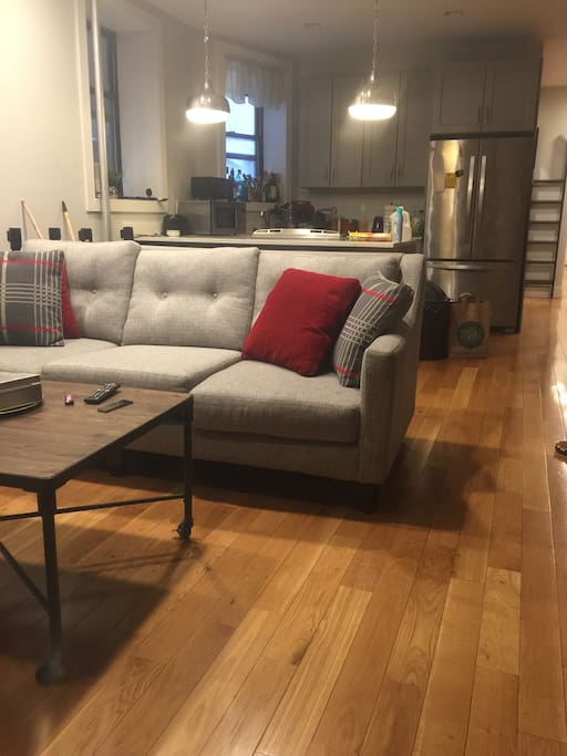 Living room couch and coffee table  Kitchen and new appliances in the rear