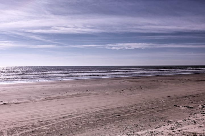 This beautiful beach home  is just steps from the white-sand shores of Brazoria County Beach!