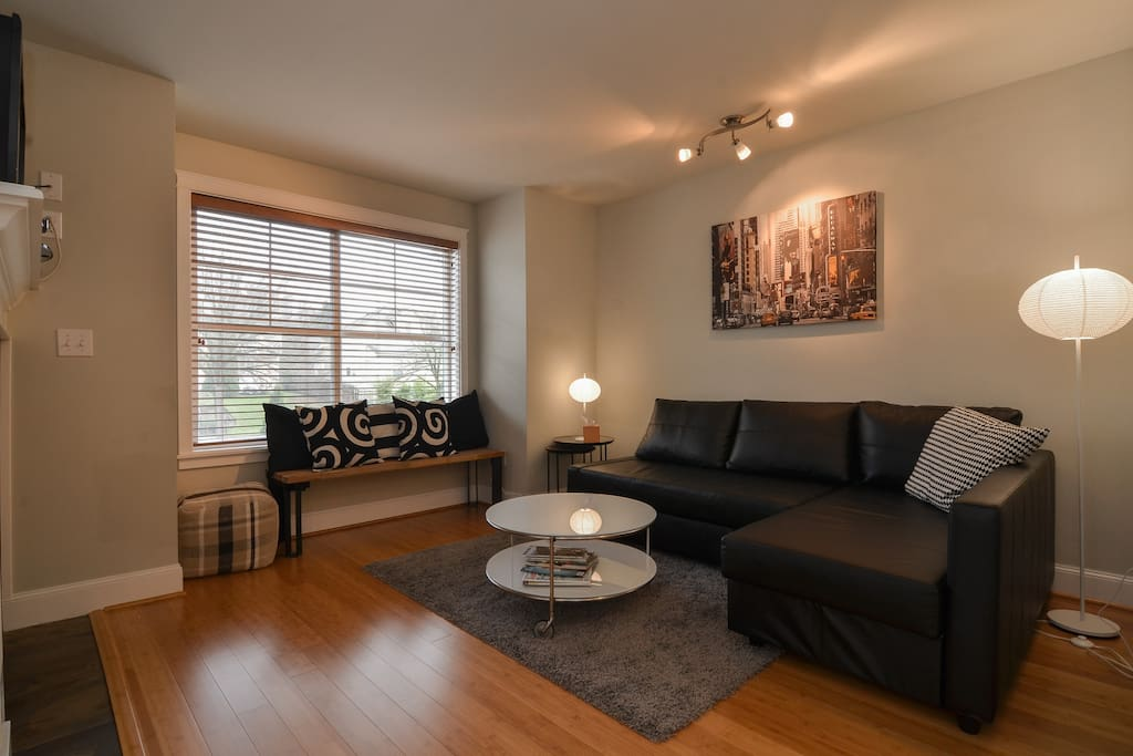 Living room with gas fireplace, leather sectional with fold-out sleeper to accommodate 2