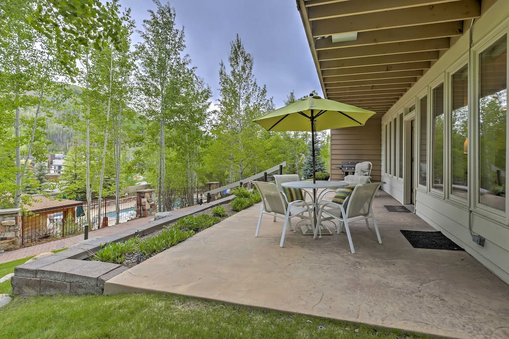 Relax and entertain from the private patio that overlooks the community pool and mountains.